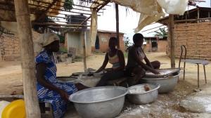 Ghanaian women preparing gari from cassava